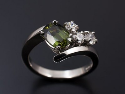 Platinum Hand Made Twist Ring with an Oval Green Sapphire 1.97ct and Round Brilliant Diamonds; 0.30ct (2) F SI, 0.21ct F SI.