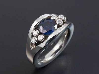 Platinum Semi Tension Set Design with a Round Sapphire 1.16ct and 6 x 2.0mm F VS Round Diamonds Total Weight 0.18ct.