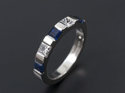 Ladies Wedding / Eternity Ring Comprising 2 x 0.10ct F VS Princess Cut Diamonds and 3 x 3mm Square Ceylonese Sapphires. Hand Made and Bar Set in Palladium.