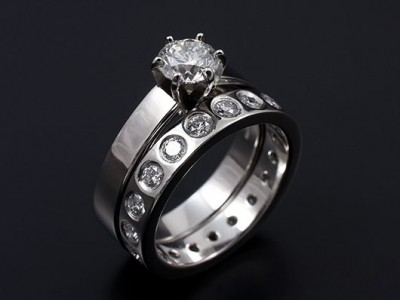 Round Brilliant 0.81ct E VS2 EXEXEX with Full Secret Set Diamond Wedding Ring all Hand Made in Platinum.
