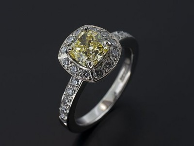 Cushion Cut 0.93ct Natural Fancy Yellow VS2 Clarity, VG Polish VG Symmetry with 22 x F VS Round Brilliant Diamonds Pave Set into Shoulders and Halo. Handmade in Palladium