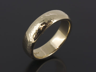 9kt Yellow Gold 6mm Width Court Shaped Gents wedding Ring with a Hammered and Polished Finish.