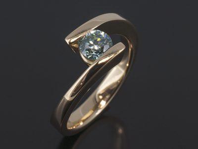 Round Brilliant Cut Blue Diamond, 0.62ct Tension Set in 9kt Yellow Gold in a Twist Design