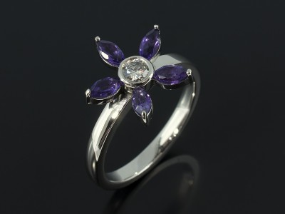 Marquise Cut Amethysts and Round Brilliant Diamond in a Palladium Floral Style Design.