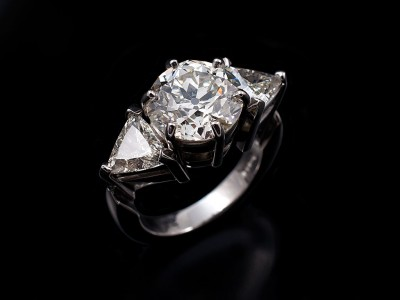 Antique 3.47ct pre 1920's Round Brilliant Diamond with 2 x 0.60ct Trilliant Cuts Hand Made in a Platinum Trilogy Setting