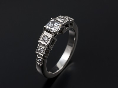 Asscher Cut 0.55ct E Colour VS1 Clarity in a Platinum Setting with 6 x Round Brilliants Pave Set into Cubed Shoulders