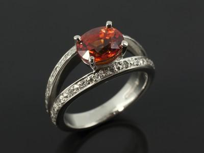 Blood Orange 1.78ct Oval Sapphire in a Palladium Diamond Pavé Set Split Band 4 Claw Design.