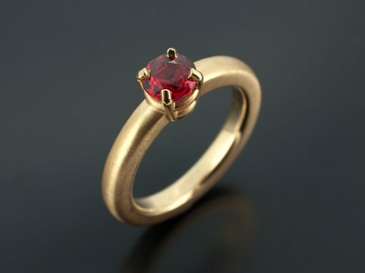Blood Orange Sapphire 0.87ct in an 18kt Yellow Gold 4 Claw Setting with Halo Shaped Band