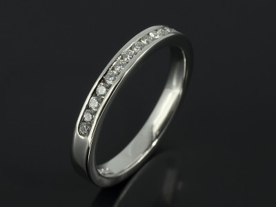 Round Brilliant Diamond Channel Set Platinum Wedding Ring.