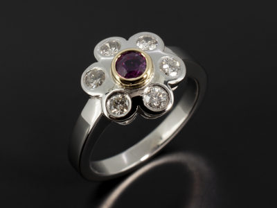 Palladium and 18kt Yellow Gold Floral Cluster Design Dress Ring with 0.29ct Ruby and Round Brilliant Cut Diamonds 0.38ct Total.