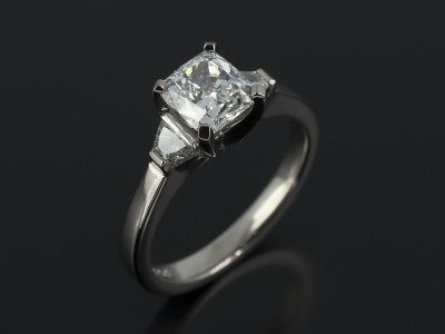 Cushion Cut 1.20ct F VVS1 EXEX with Trapezium Cut Diamonds 0.21ct in a 18kt White Gold Trilogy Setting.