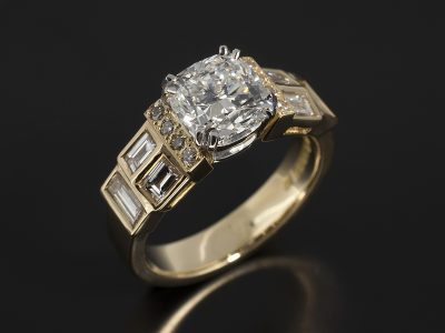 Cushion Cut Diamond 1.76ct D Colour SI1 Clarity with Pave Set Round Brilliant Cut Diamonds 0.08ct (8) and Rubover Set Baguette Cut Diamonds 0.64ct (6) Set in Platinum with a Double Claw Design and 18kt Yellow Gold Shank