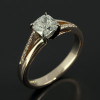 Cushion Cut 0.60ct G Colour SI1 Clarity 18kt White and Rose Gold Setting with Diamond Set Split Shoulders Design.