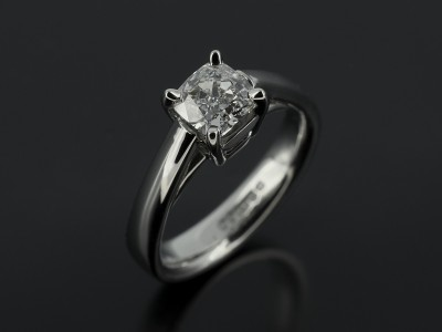 Cushion Cut 0.77ct G Colour VS2 Clarity in a 4 Claw Platinum Setting with Gapped Raised Shoulders.
