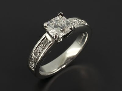 Cushion Cut 0.91ct D Colour VS2 Clarity EXEX in a Platinum 4 Claw Setting with Pavé Set Diamond Shoulders.