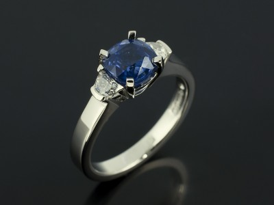 Cushion Cut Sapphire 1.51ct and Half Moon Cut Diamonds F Colour VS Clarity Min in a Platinum Claw Set Trilogy Design.