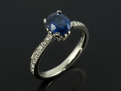 Cushion Cut Sapphire 1.65ct in Scroll Detail Setting with Pavé Set Diamond Shoulders in Platinum.