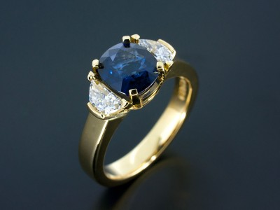 Cushion Sapphire 2.07ct with Half Moon Cut Diamonds 0.47ct Total in a 18kt Yellow Gold Trilogy Design.