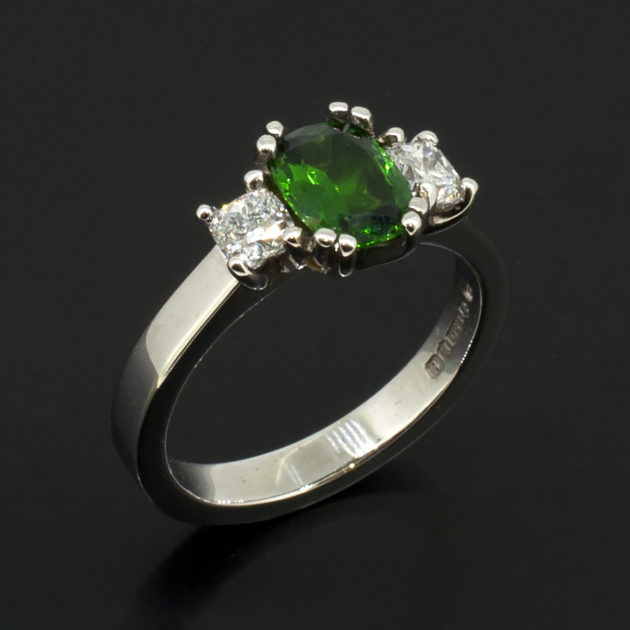 Platinum trilogy ring with cushion cut tsavorite and diamond settings, tsavorite and diamond dress ring, bespoke tsavorite and diamond ring, trilogy ring with tsavorite and side diamonds, platinum trilogy ring glasgow