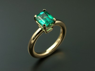 Emerald 1.14ct set in an 18kt Yellow Gold Setting with a Halo Band