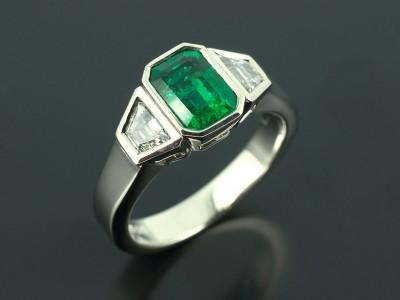 Emerald 1.36ct with Trapezium Step Cut Diamonds F Colour VS Clarity Min 0.38ct Total in a Palladium Rub Over Trilogy Design Copy
