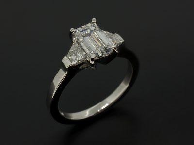 Emerald Cut Diamond 1.01ct D Colour VVS1 Clarity with Step Cut Trapeziums 0.40ct (2) F Colour, Vs Clarity Set in Platinum in a Trilogy Design