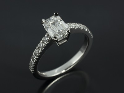 Emerald Cut 1.01ct E Colour SI1 Clarity in a Platinum 4 Claw Setting with Diamond Set Shoulders.