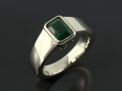 Emerald 1.09ct in an 18kt White Gold Rub Over Setting with Tapered Band.