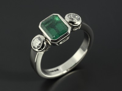 Emerald 1.50ct with 2 x Round Brilliant Cut Diamonds F SI Minimum 0.51ct Total in a Palladium Rub Over Trilogy Setting.