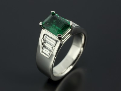 Platinum 4 Claw and Channels Set Design with Emerald Cut Emerald 1.65ct and 6 x Baguette Cut Diamonds 0.88ct Total.