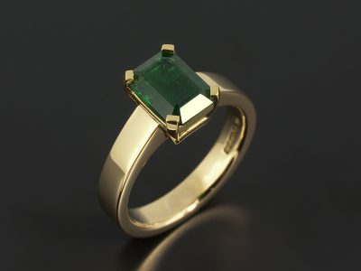 Colombian Emerald 1.89ct in a 4 claw 18kt Yellow Gold Contemporary Solitaire Design.