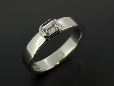 Emerald Cut 0.30ct F Colour VS1 Clarity Ex Polish Ex Symmetry in a Palladium Rub Over Sideways Design