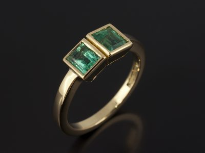 Baguette Cut Emeralds 0.40ct and 0.45ct in an 18kt Yellow Gold Rub Over Set Contemporary Design.