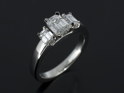 Emerald Cut 0.61ct E Colour VS1 Clarity with 2 x Emerald Cut Side Diamonds 0.41ct F VS in a Palladium Trilogy Design.