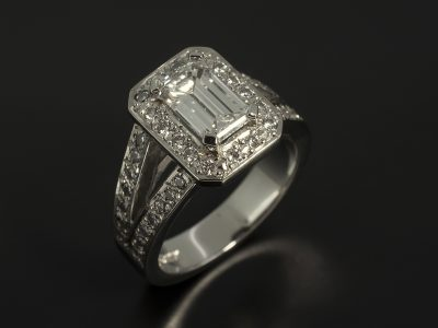 Emerald Cut Diamond, 0.92ct, D Colour SI1 Clarity, Excellent Polish, Very Good Symmetry Four Claw Set In Platinum with a Round Brilliant Cut Diamond, 0.44ct (44), Pavé Set Halo and Split Shoulder Design