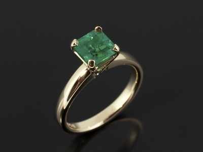 Asscher Cut Emerald 0.89ct in a 9kt Yellow Gold 4 Claw Solitaire Design with Tapered Basket Setting.