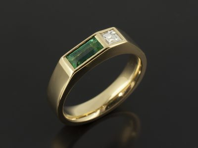 Baguette Cut Emerald 0.40ct with Carré Cut Diamond 0.17ct F VS in an 18kt Yellow Gold Rub Over Set Design.