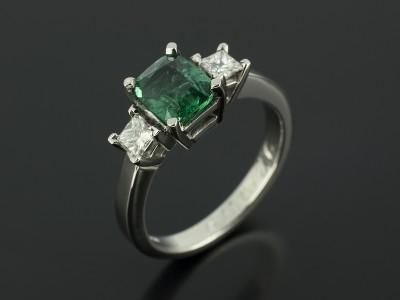 Emerald Cushion Cut 1.20ct with 2 x Princess Cut Diamonds 0.37ct Total F Colour VS Clarity Min in a Palladium Trilogy Setting