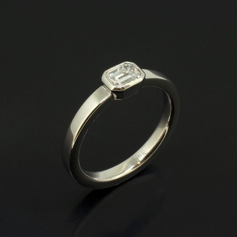 emerald cut diamond engagement ring, white gold rub over diamond ring, 18kt white gold diamond ring, hand made diamond engagement ring Glasgow, horizontal set emerald cut diamond ring, F colour emerald cut diamond ring