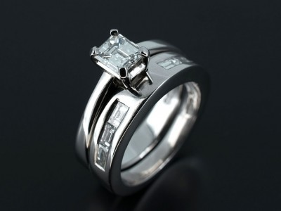Emerald Cut 0.58ct E Colour VS2 Clarity in Platinum with Fitted Baguette Cut Channel Set Wedding Ring.