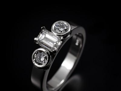 Emerald Cut 0.72ct F Colour VS2 Clarity with 2 x 0.20ct F Colour VS Clarity Minimum Round Brilliant Diamonds Hand Made in Platinum
