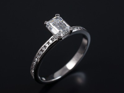 Emerald Cut 0.73ct E VS1 in a 4 Claw 18kt White Gold Setting with Full Pave Set Diamond Band