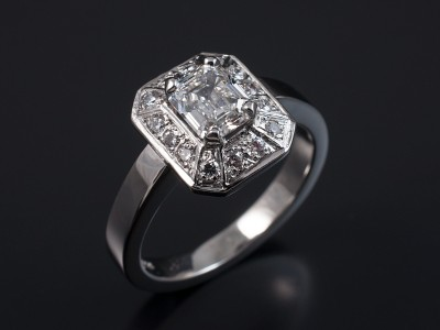 Emerald Cut 0.92ct E VS2 in an 18kt White Gold Halo Setting with Pave Set Round Brilliant Diamonds