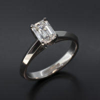 Emerald Cut 0.93ct E Colour VS1 Clarity in a 4 Claw Platinum Setting with Knife Edged Split Shoulders Band.