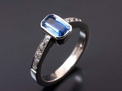 Emerald Cut Sapphire 0.89ct with Pave Set Shoulders in an 18kt White Gold Rub Over Setting. Copy