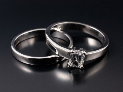 Emerald Cut 0.58ct E Colour VS1 Clarity in a 4 Claw Platinum Setting with Fitted Wedding Ring