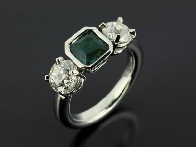 Emerald Square Step Cut 0.58ct with 2 x 0.70ct Round Brilliant Diamonds in a Palladium Trilogy Design