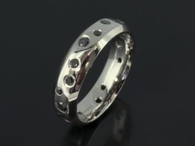 Gents Palladium Chamfered Edge Scattered Secret Set Black Diamond Engagement Ring.