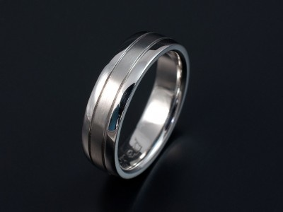 Gents Platinum Wedding Ring with 2 Grooved Lines.