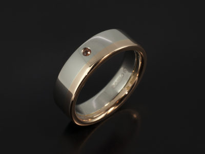 Gents Platinum and 18kt Red Gold Two Tone Wedding Ring. 6mm Width with Orange Secret Set Sapphire.